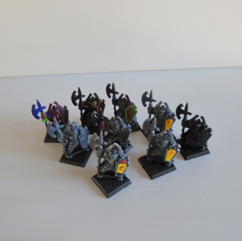 Quantity of 9 fighting figurines holding axes and shields. For either Warhammer, Dungeons and Dragons, or Mage Knight.