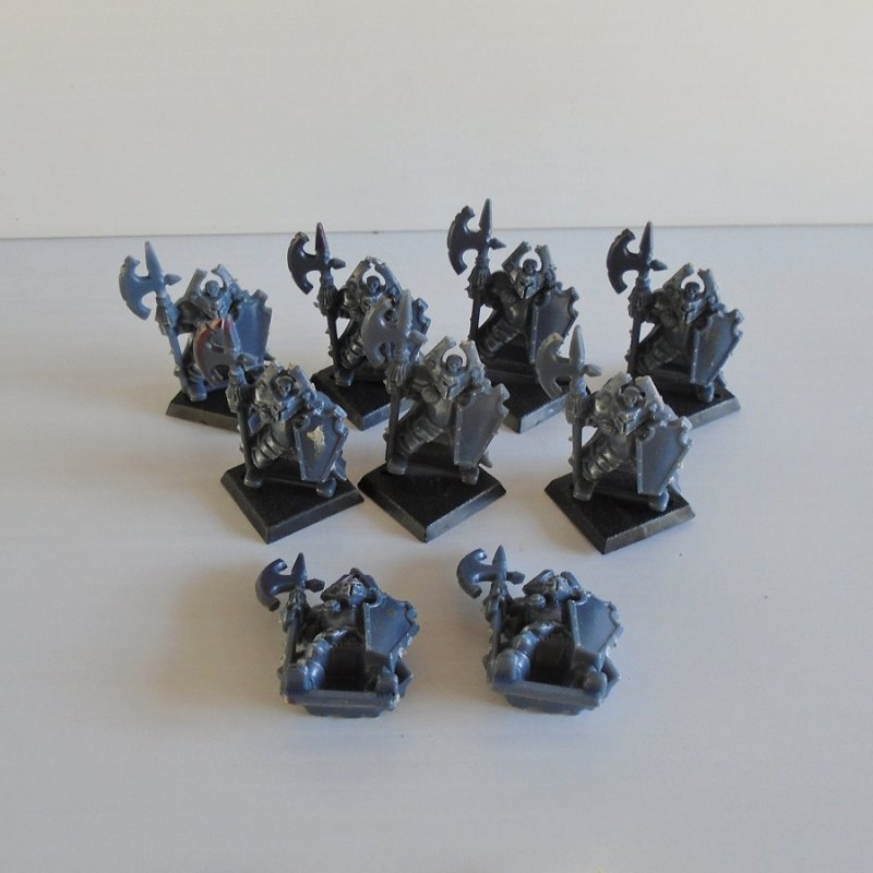 Quantity of 9 fighting figurines holding axes and shields. For either Warhammer, Dungeons and Dragons, or Mage Knight. Unpainted.