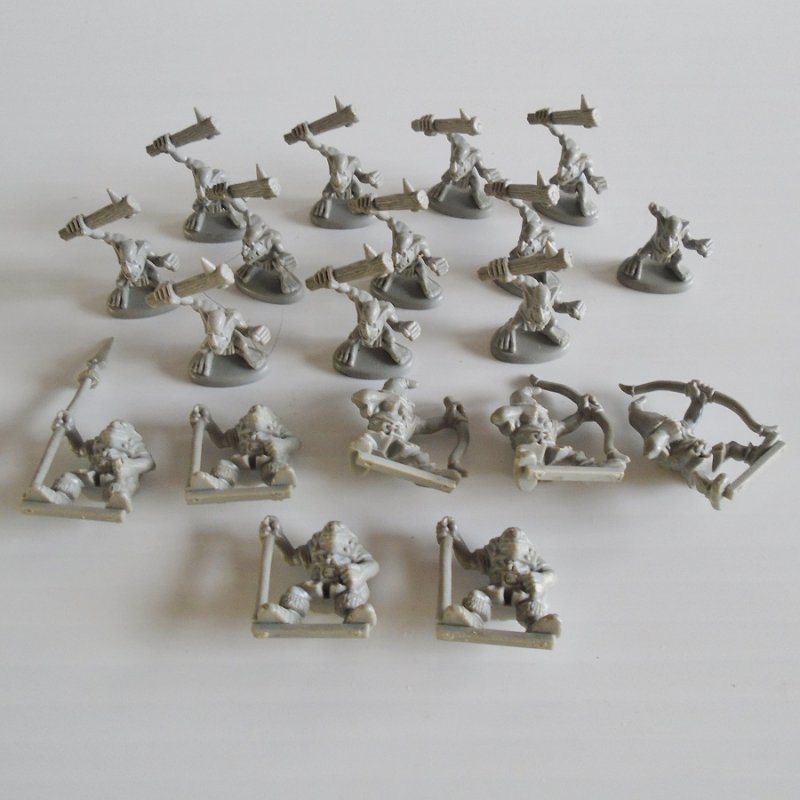 Quantity of 19 miniature fighting figurines. For either Warhammer, Dungeons and Dragons, or Mage Knight. 3/4 to 1 inch tall. All unpainted.