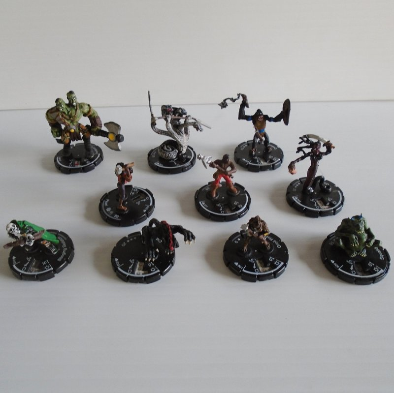 Quantity of 10 fighting figurines on dials for either Warhammer, Dungeons and Dragons, or Mage Knight. All marked Wizkids