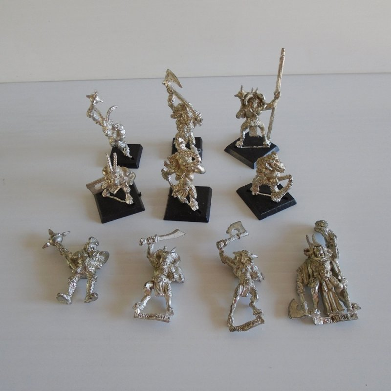 Games Workshop Warhammer 10 goat head warriors. Each swinging a weapon. Unpainted metal. May also be for the Dungeons and Dragons or Mage Knight game.