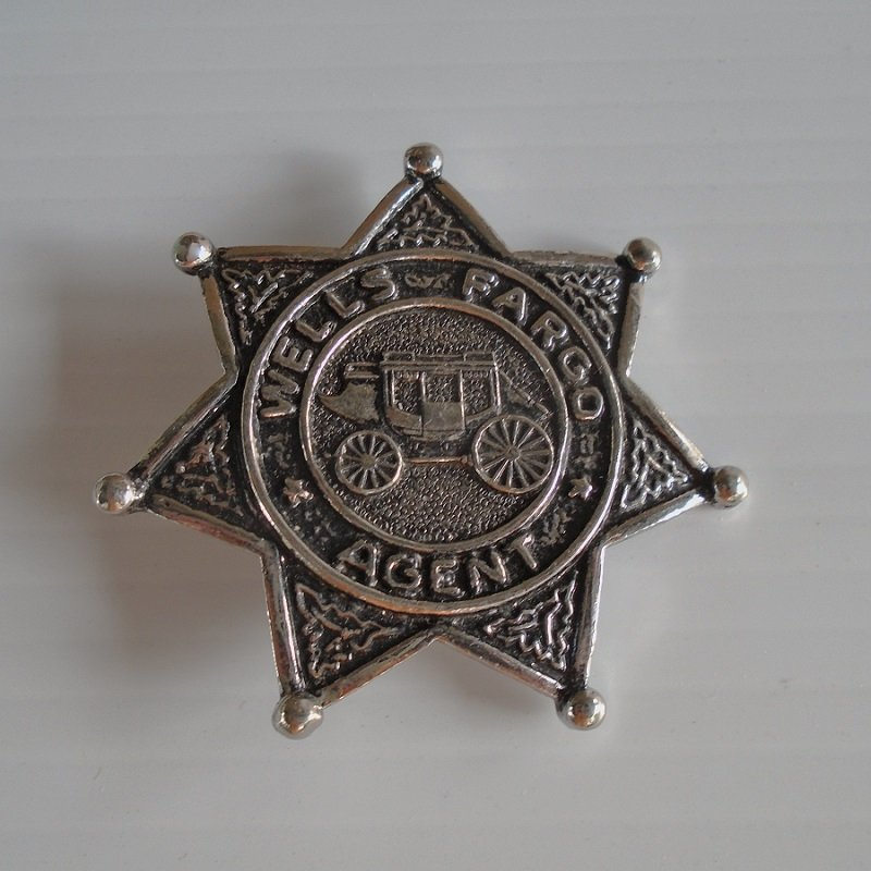 Wells Fargo agent badge. 7 point star. Features stagecoach in center. 2.25 inches across. Estate purchase.