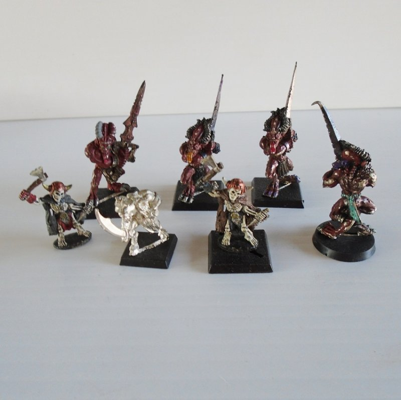 Games Workshop, Warhammer, Dungeons and Dragons, Mage Knight, or Necromancer fighting ghouls or monsters. All are metal.
