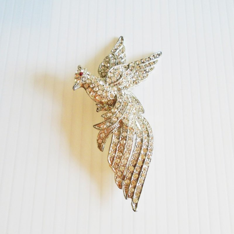 Rhinestone encrusted bird brooch. Vintage 1920s - 1930s pot metal. 3.75 inches tall. Excellent condition. Estate purchase.