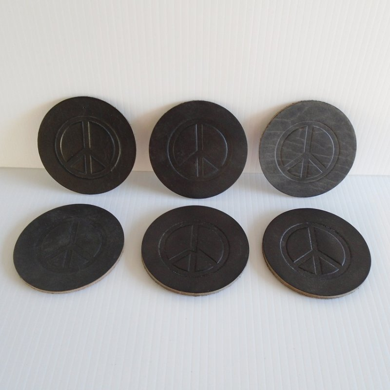 Peace sign coasters, black leather. Set of 6.  3.5 inches round. Estate purchase.