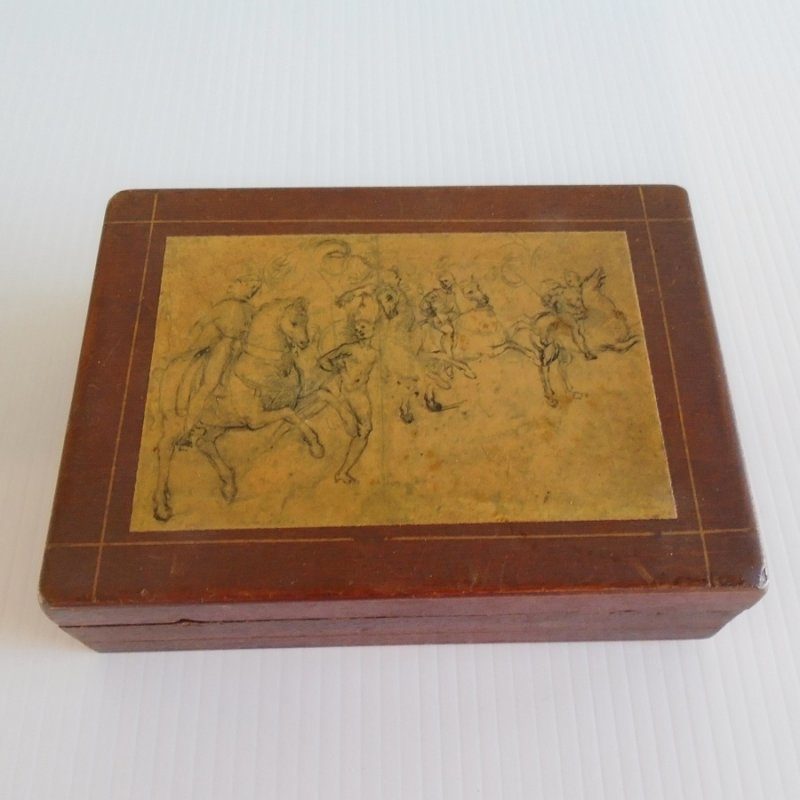 Cigarette box, trinket box, small jewelry box, desk storage box, multi use box. At least 50 years old. Battle scene on top. Wood.