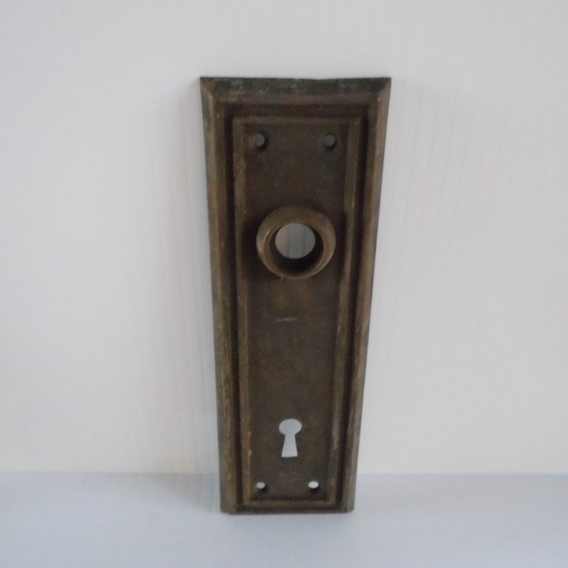 Architectural Salvage brass doorknob back plate escutcheon. 7 by 2.25 inches. Unknown age, probably late 1800s - early 1900s.
