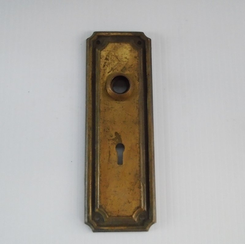 Architectural Salvage brass doorknob back plate escutcheon. 7 by 2.5 inches. Unknown age, probably late 1800s - early 1900s.
