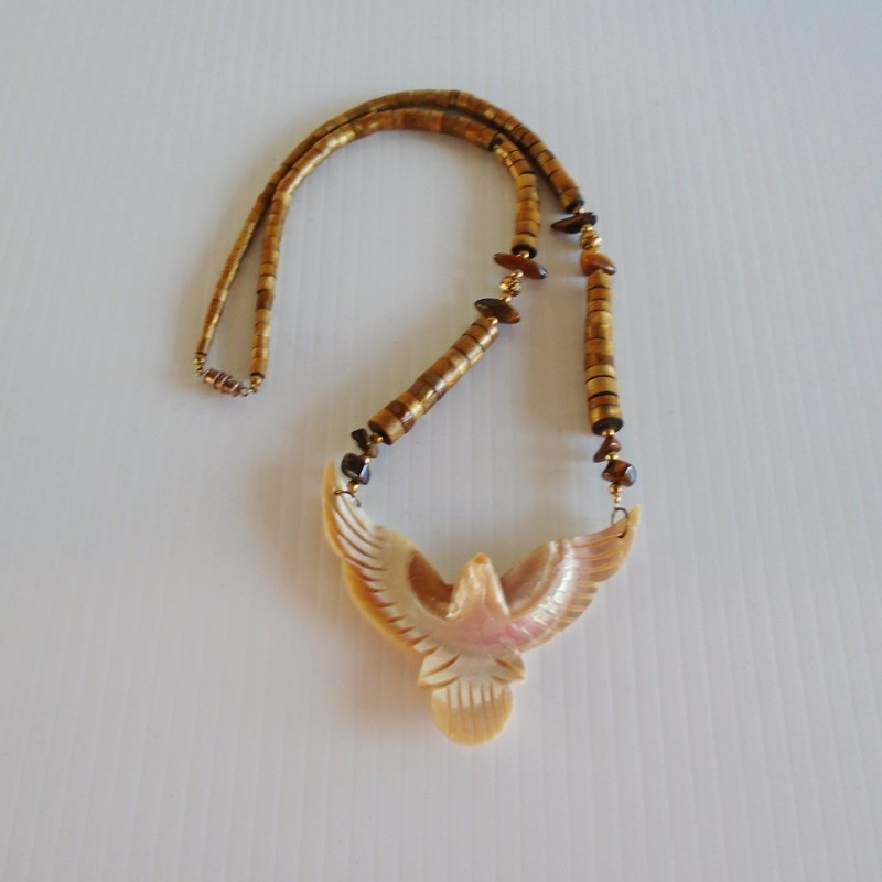 Mother of Pearl carved Eagle in flight necklace. Wood 'chain' with Tiger's Eye stone highlights. Vintage Native American estate sale purchase.