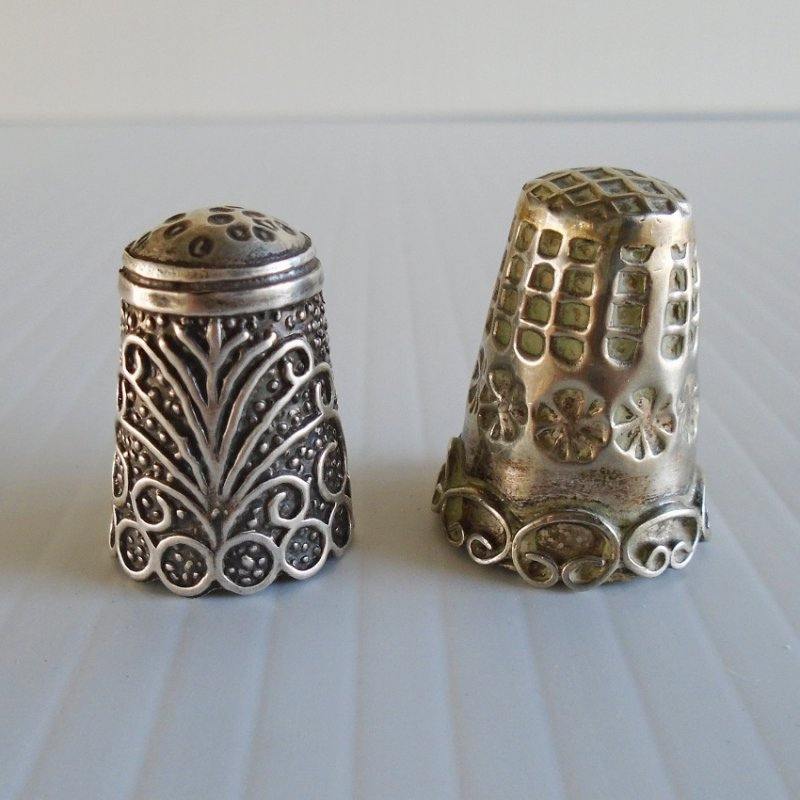 Actual silver thimbles from Mexico. Both acid tested. Hecho en Mexico. Unknown dates on both. Estate find.