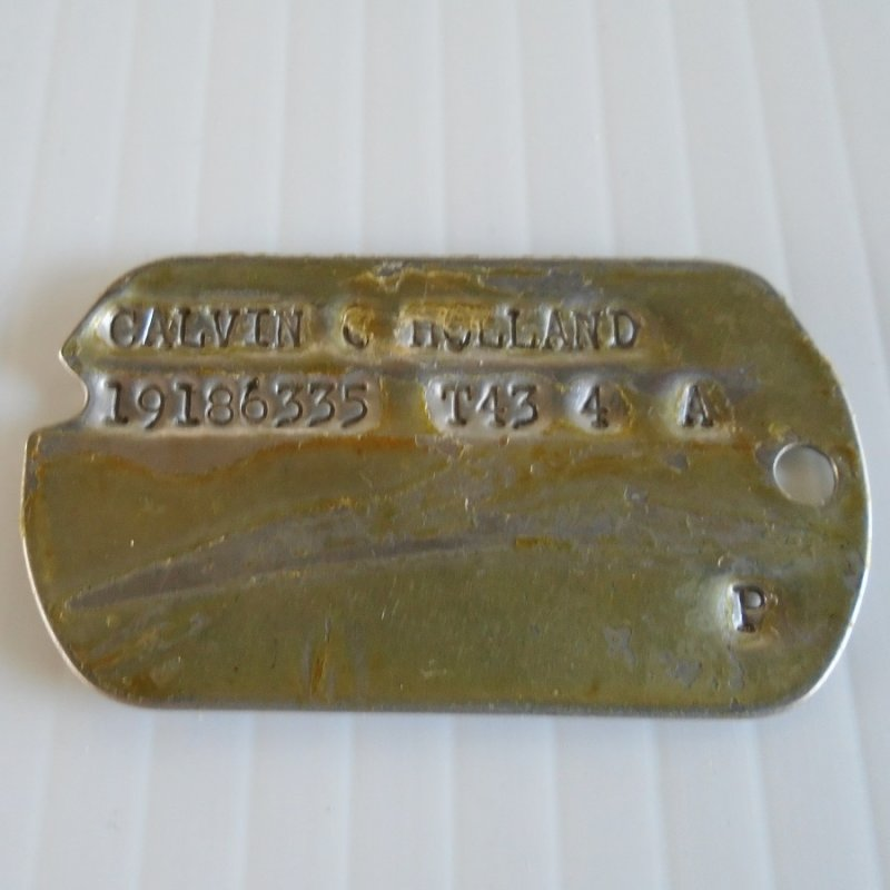 U.S. Army WWII Military Dog Tag for Calvin C. Holland. Dates 1943 to 1944.