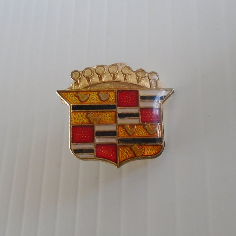 Cadillac emblem lapel pin. Can also be used as a hat pin or a tie tack. At least 30 years old. Estate find.