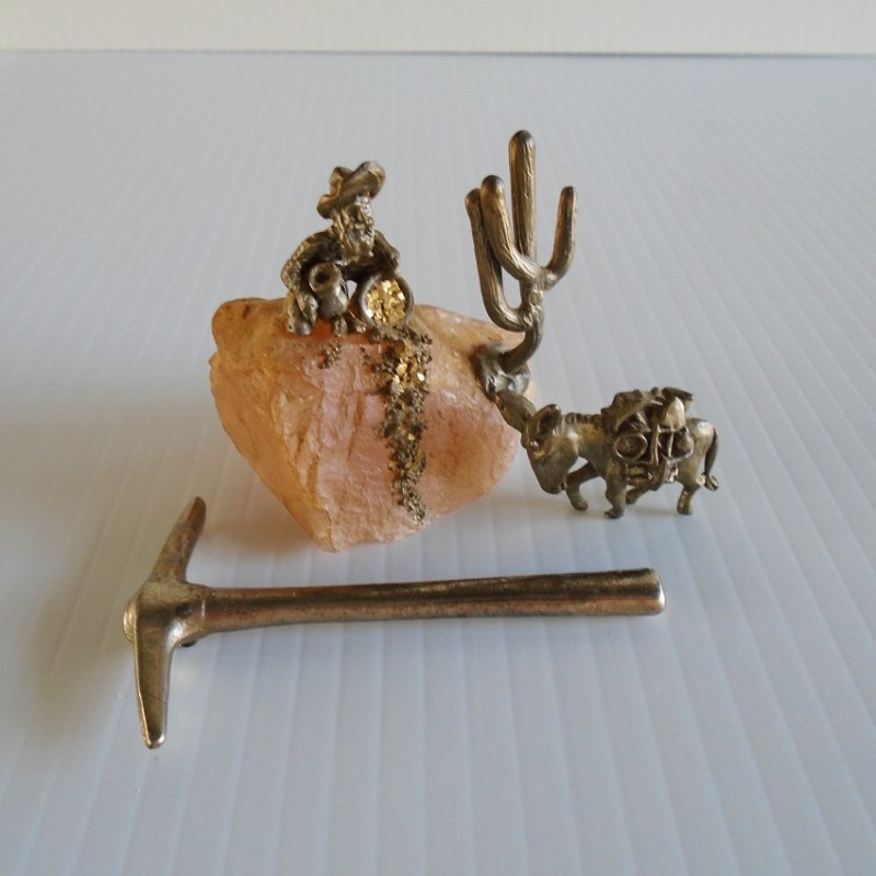 Gold mining statues. Miner on pink rock, Saguaro cactus, donkey, pick axe. Over 20 years old.