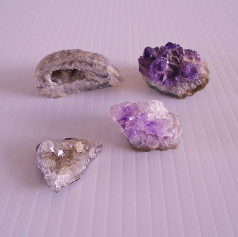 Amethyst geodes. Quantity of 4. If round, 2 of the 4 would be golf ball size, the others are a little smaller. Estate purchase.
