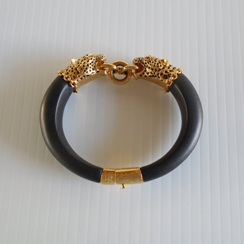 Duchess of Windsor replica Panther head bracelet. 22k heavily coated, with ruby gemstones for the eyes. From Franklin Mint, dated 1987. Signed. Estate purchase.
