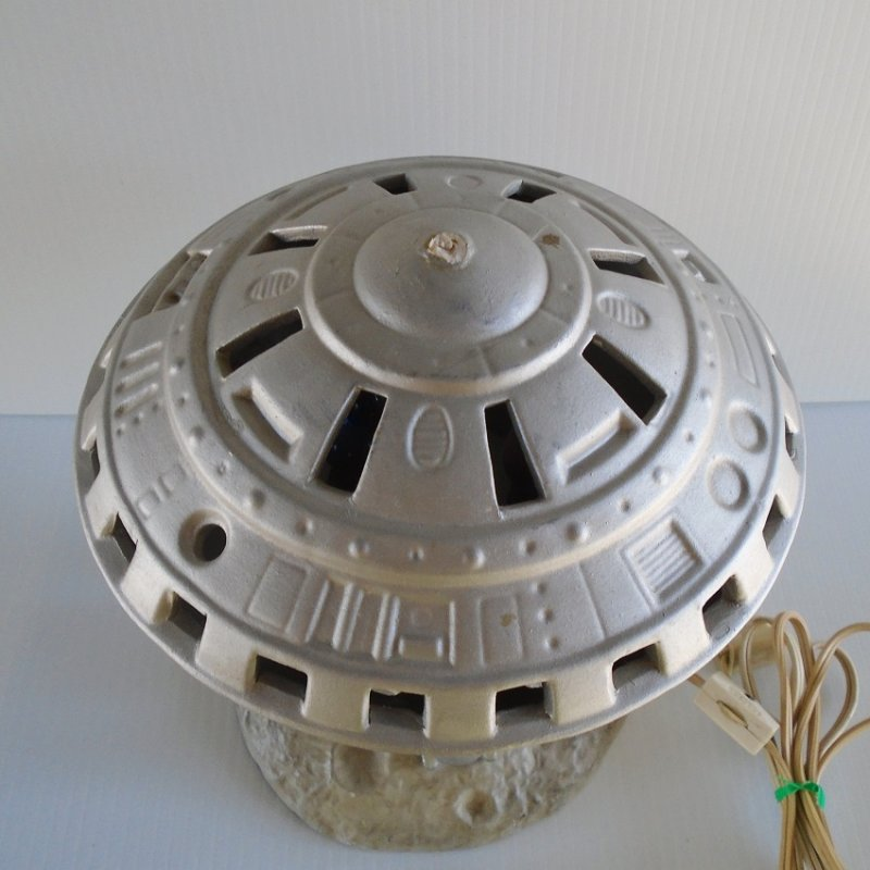 Mid century UFO Alien Spaceship sitting on the moon table top night light lamp. Flashing lights, alien man, probably ceramic. Estate purchase.