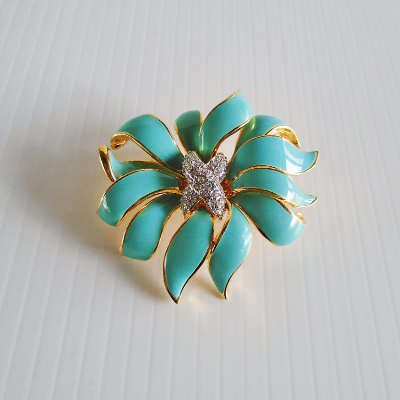 KJL Kenneth Jay Lane turquoise enameled flower brooch with center of pave set rhinestones. Signed. Estate purchase.