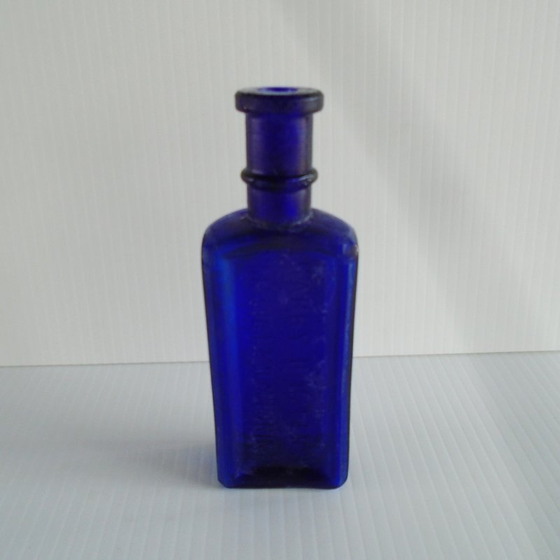 Harry D. Haber's Magic Hair Coloring Bottle. Circa 1880s to 1890s. Cobalt blue. 2 by 1 by 6 inches tall. Estate purchase.