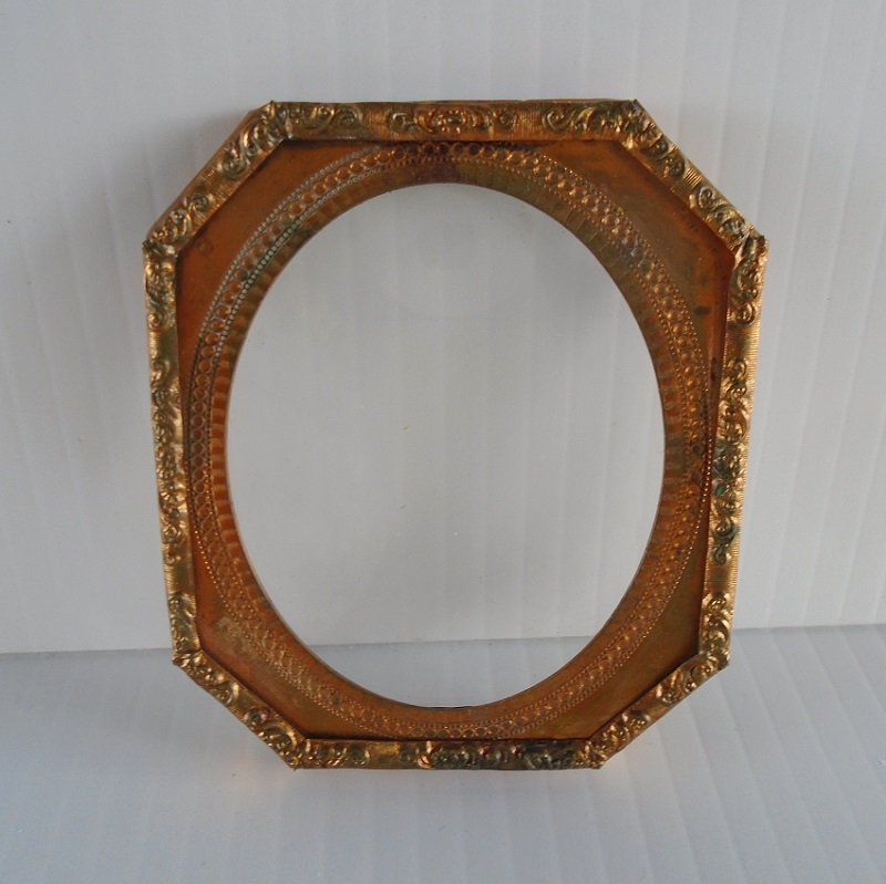 Front view of mid to late 1800s handmade copper picture frame.