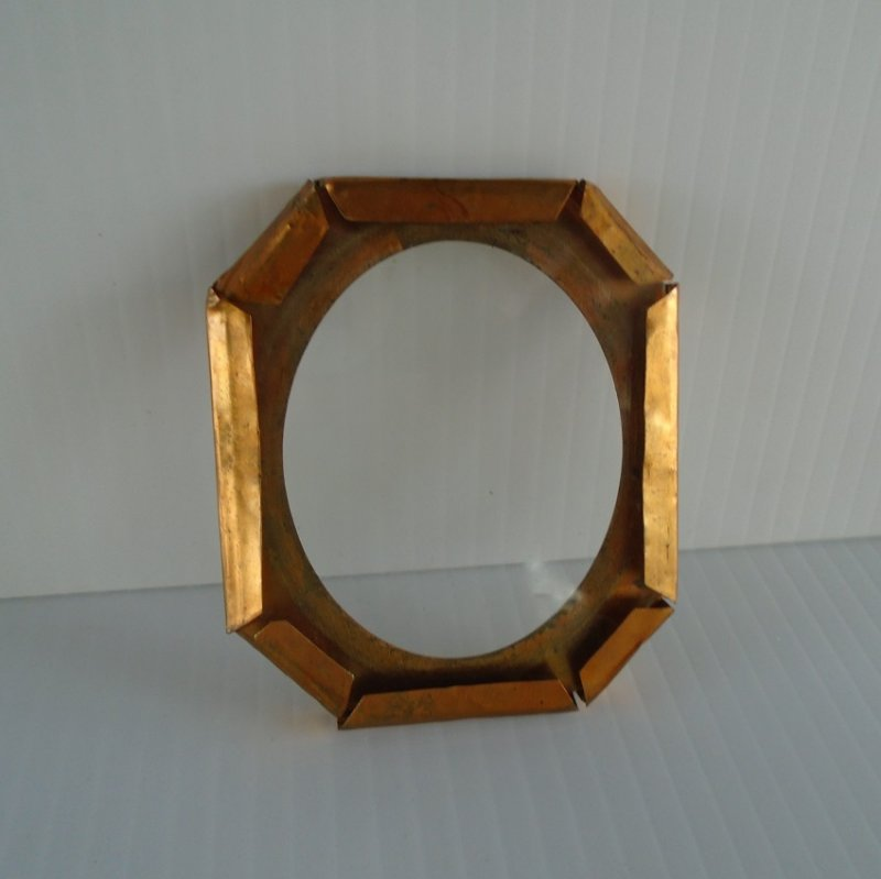 Back view of mid to late 1800s handmade copper picture frame.