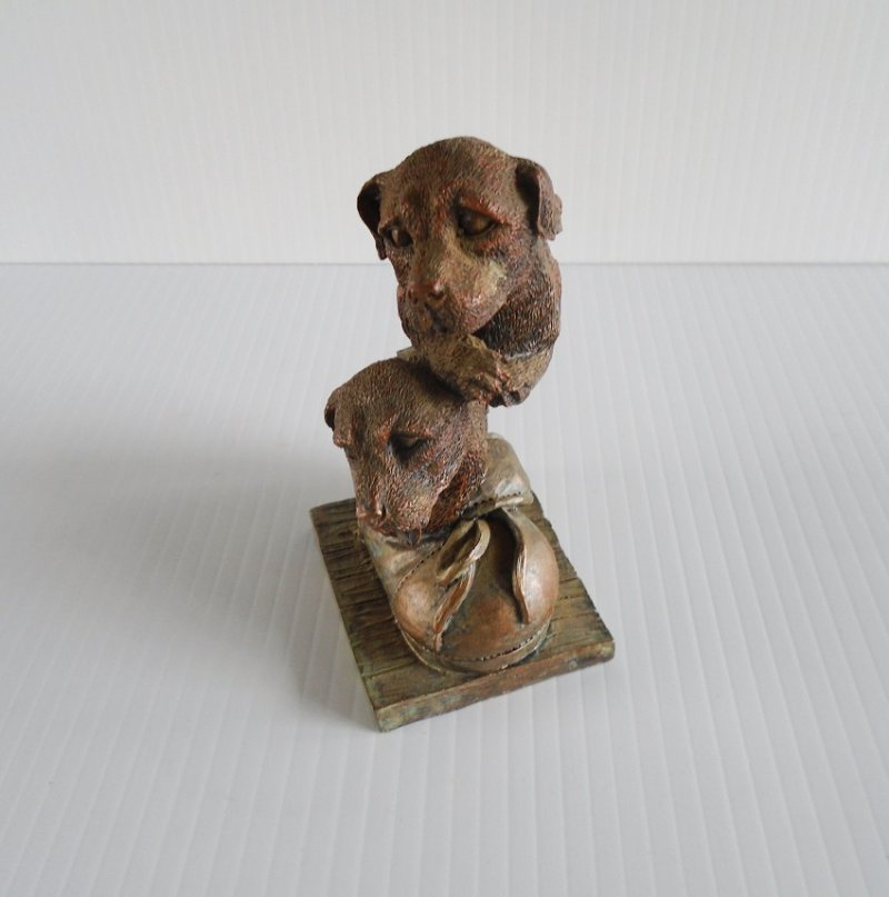 Statue of puppy dogs sitting in a shoe. Stands 4.5 inches tall
