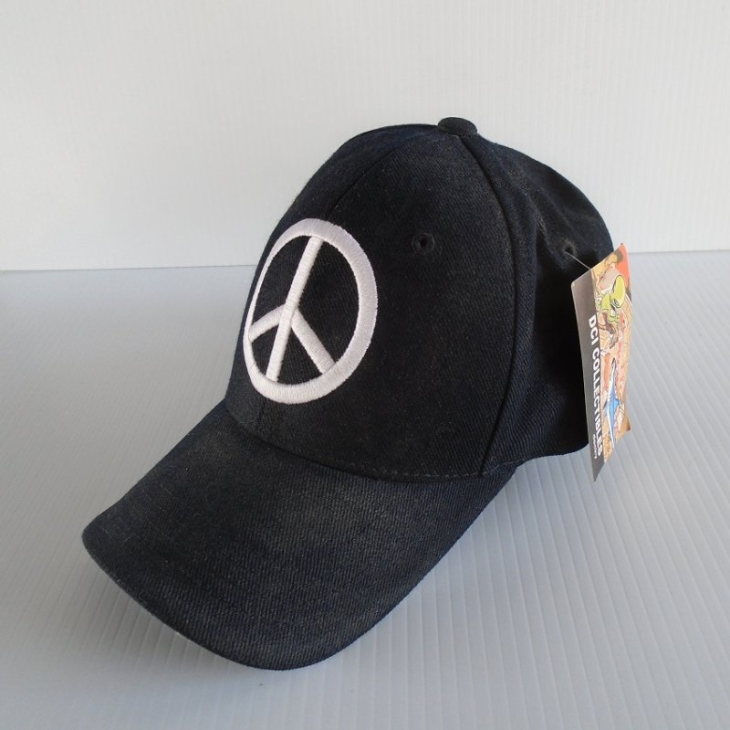 Peace sign baseball type cap. Never worn and still has paper and cloth tags. From DCI Collectibles. Unknown age, estate sale find.