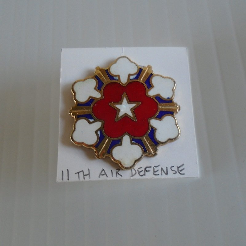 11th US Army Air Defense Artillery Brigade DUI insignia pin. Marked N.S. Meyer, New York, Made in USA. Estate purchase.