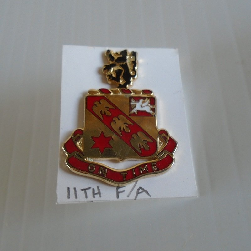 11th US Army Field Artillery Regiment DUI insignia pin. Has the motto of