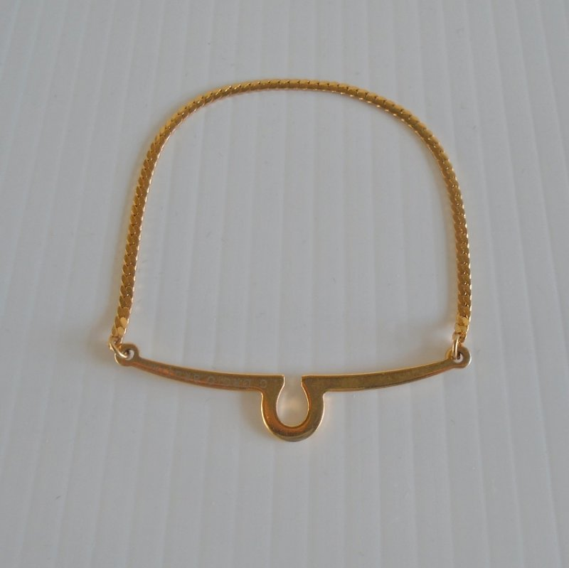 Vintage Giorgio Brutini Tie Bar with hang chain. Gold in color. Estimated to be 1970s.