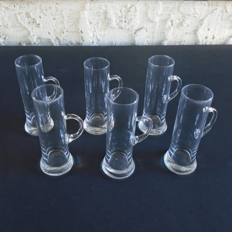 Mug style Cordial glasses. Circa 1959-1960 mid century. Set of 6 clear glass. 4 inches tall. Stated as probably never used. Estate purchase.
