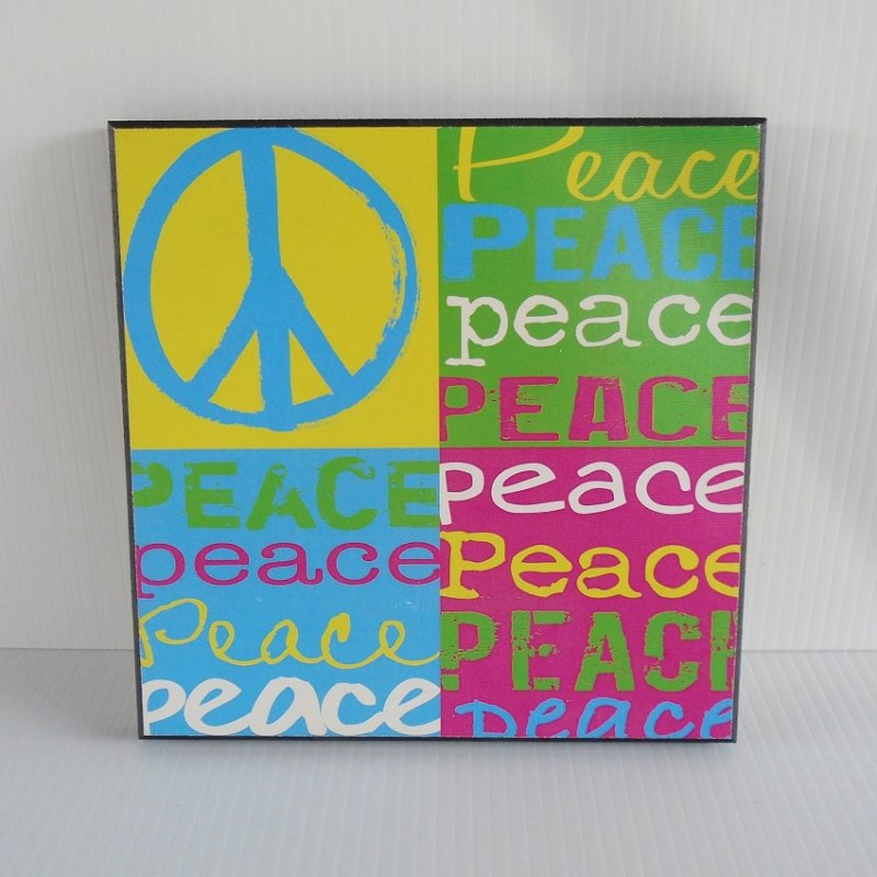 Colorful Peace Sign plaque. Made of wood. Measures 8 by 8 by 1/2 inch. Can hang on wall or stand. Excellent condition. Estate sale find.