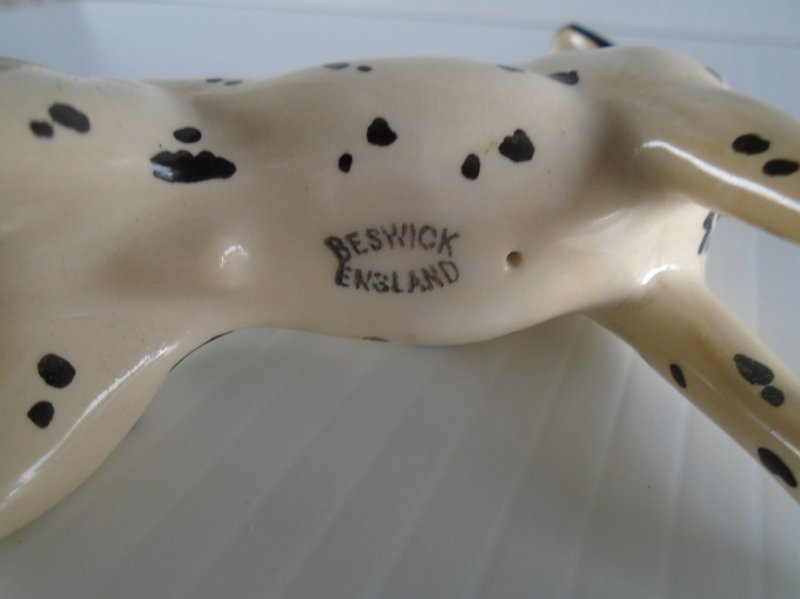 Porcelain Dalmatian dog figurine. Marked Beswick England. Stated to be 1950s. Estate sale find.