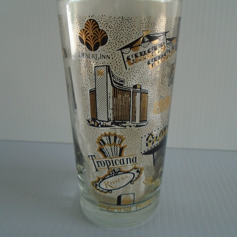 Las Vegas casinos drinking glass. Features closed casinos Aladdin, Landmark, Mint, Showboat, Stardust and others. Pre 1988. Never used, displayed only