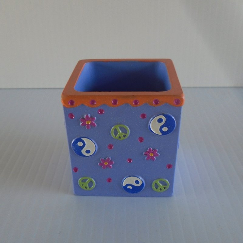 Lavender in color, this Claire's ceramic box features peace signs and flowers. 2.25 inches square. Estate sale find.
