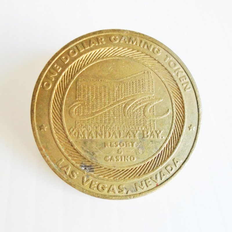 Las Vegas Mandalay Bay Resort Hotel and Casino $1 metal chip gaming token. Unknown age. Purchased at an antiques store in Vegas.
