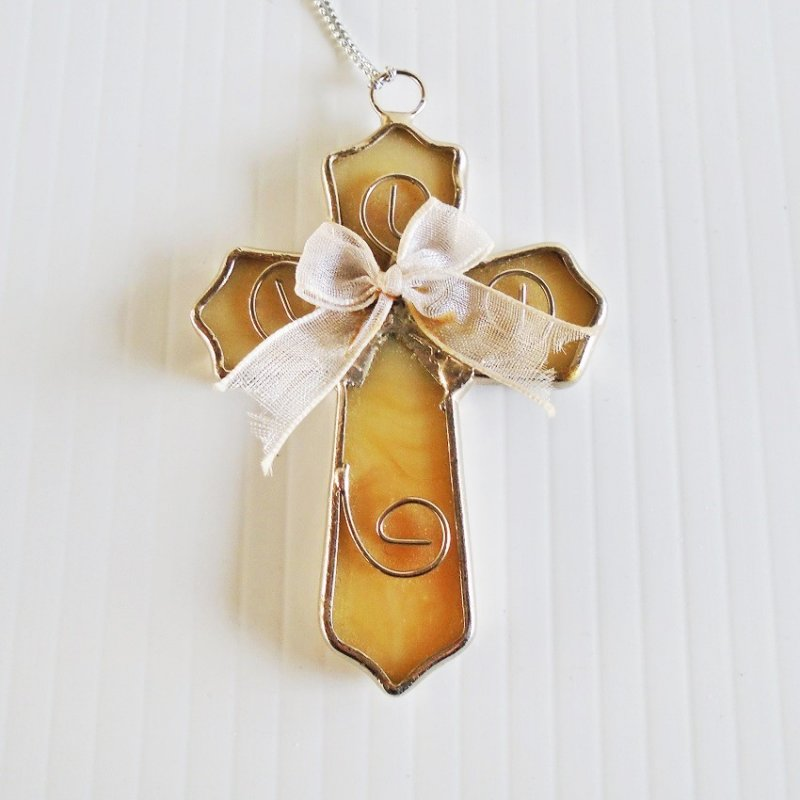 Stained glass Christmas ornament cross with silk ribbon. 3 inches tall. Off white in color. Estate purchase.