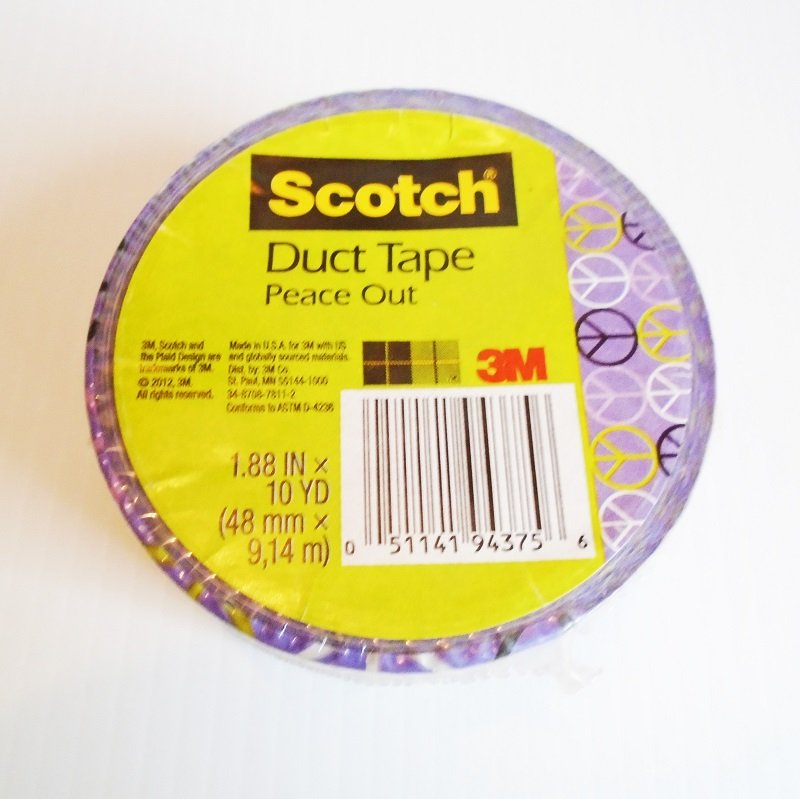 Peace sign 3M Scotch duct tape. 2 inch by 10 yards. Base color of purple with yellow, white, pink, and black peace signs.