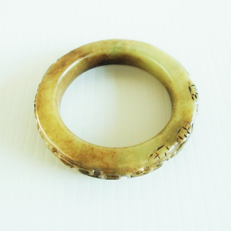 Chrysoprase bangle bracelet. Thick gemstone material with Asian design. 1970s or earlier. Estate find.