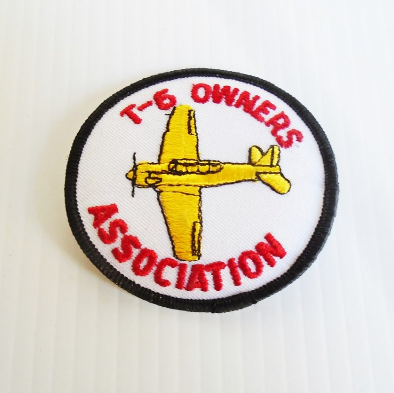 T-6 owners association patches. Set of 2, new, never sewn onto any clothing item. Both exactly alike and show vintage WWII T-6 aircraft.