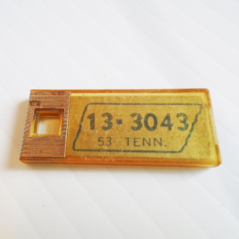 Tennessee mini license plate dated 1953. Originally used with keychains. Originally distributed by Disabled American Veterans.