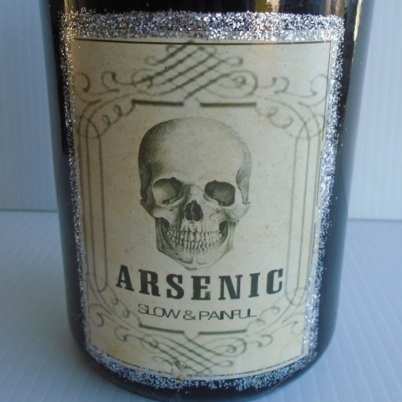 Decorative  bottle labeled Arsenic. 8 inches tall, black in color.