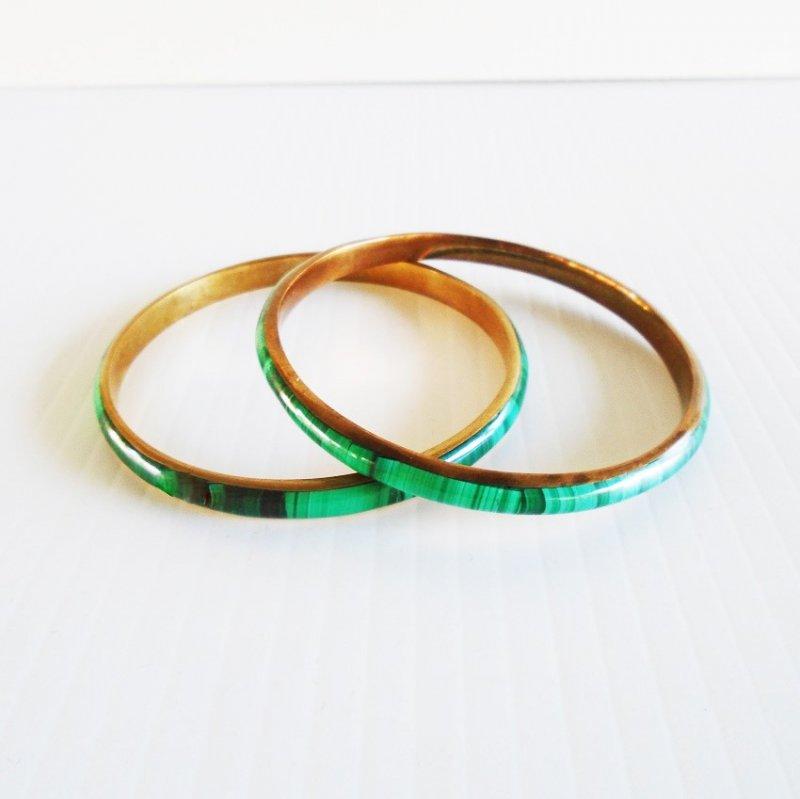 Malachite on brass bangle bracelets, set of 2. Estimated to be 1970s.