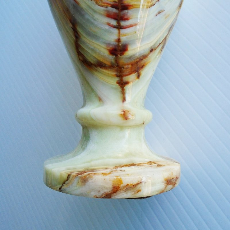 Brown swirled marble table lighter. Six inches tall. Marked Japan. Stated to be 1960s. Estate find.