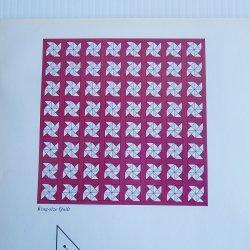 '.Quilt Pattern titled Pinwheels.'