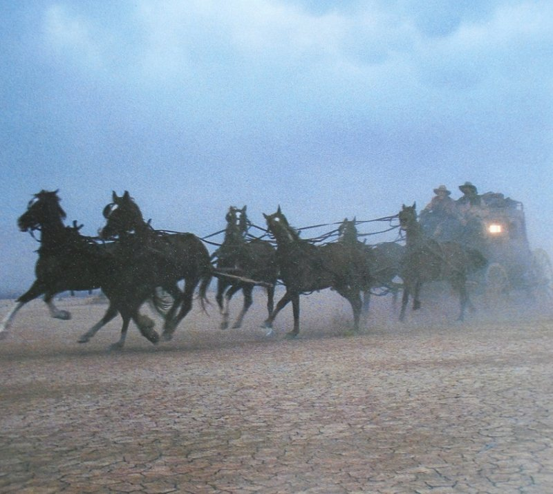 Wells Fargo Bank action poster featuring horses and stagecoach racing across the plains. 14 by 20 inch. Ready to frame.