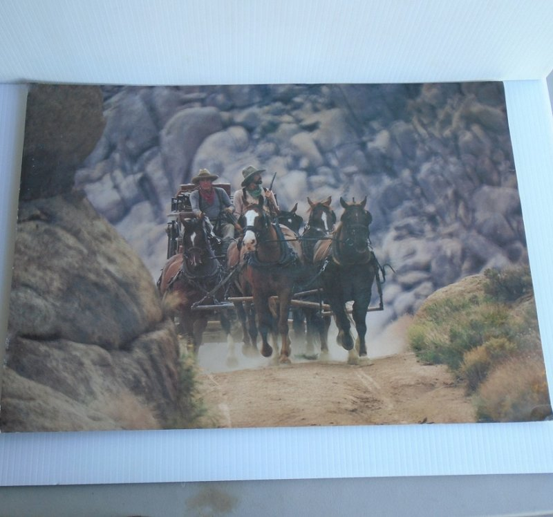 Wells Fargo Bank action poster featuring horses and stagecoach racing thru a mountain pass. 14 by 20 inch. Ready to frame.