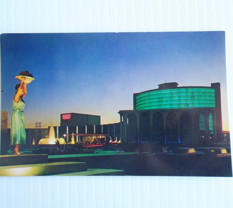 Vintage 1966 - 1970s postcard of Caesars Palace Las Vegas at dusk. Postally unused.