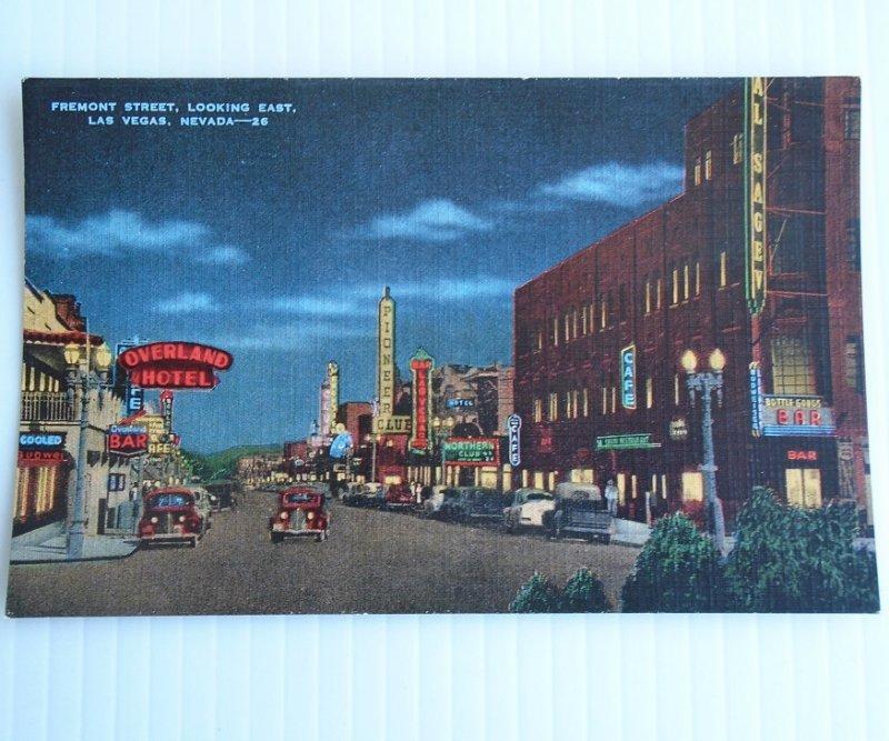 Vintage linen postcard of downtown Las Vegas NV. Shows Overland Hotel, Frontier, Pioneer, Las Vegas, Northern Club, restaurants bars. Postally unused