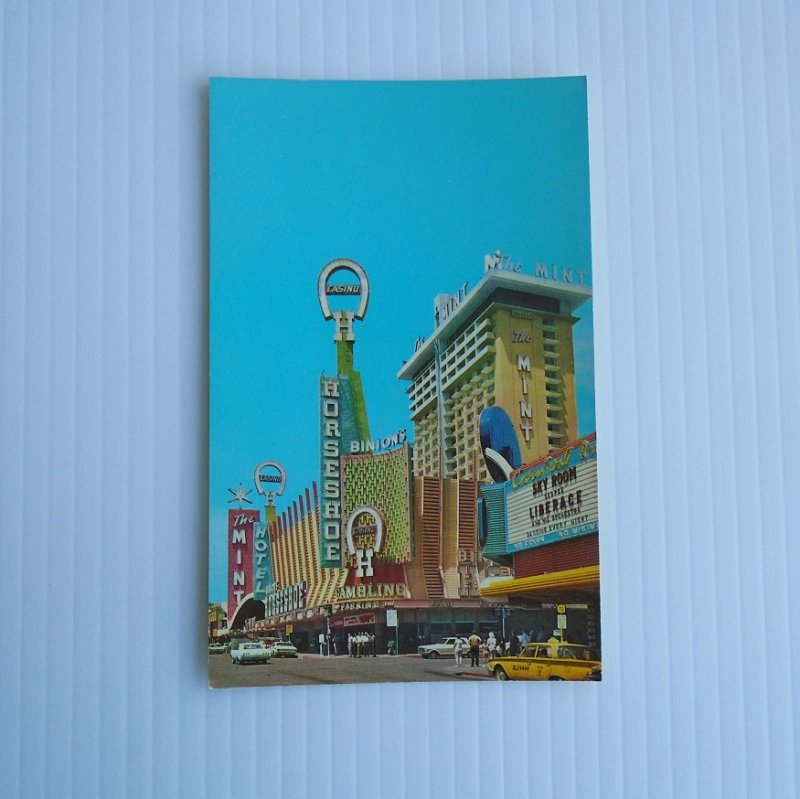 Vintage 1960s postcard of Fremont and Second Streets in downtown Las Vegas NV. Shows The Mint, Binion's Horseshoe, Sky Room.