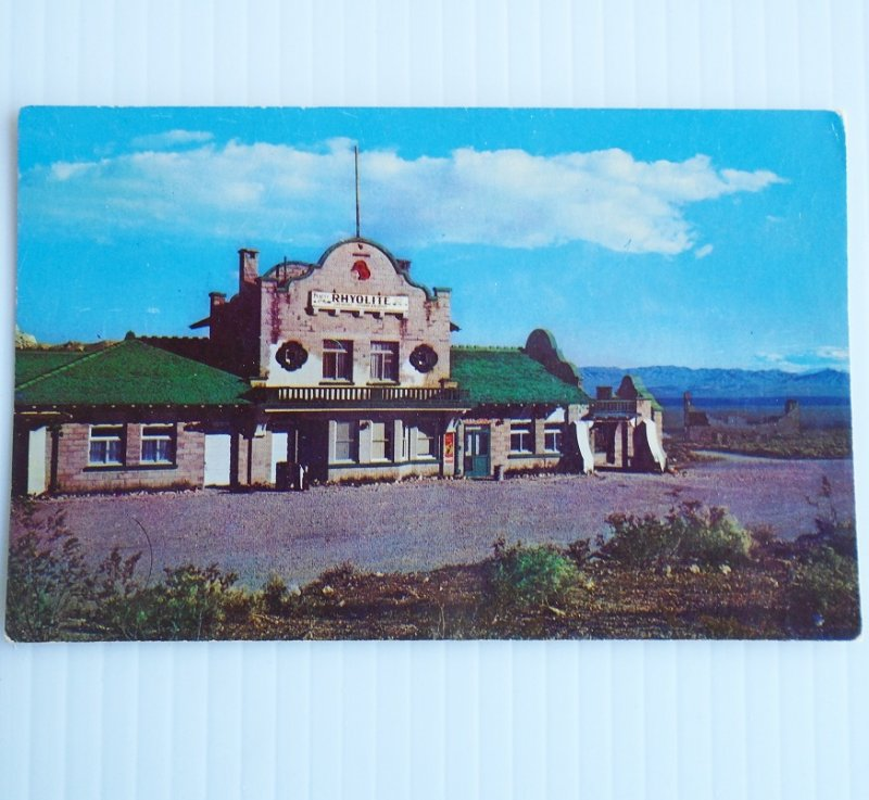 Vintage 1950s to 1960s postcard of the Rhyolite Nevada Railroad Depot. The view is of the main entrance of this Ghost Town building.